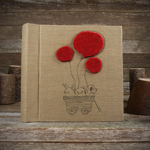 linen letterpress printed album with felt patch: friends in wagon with balloons