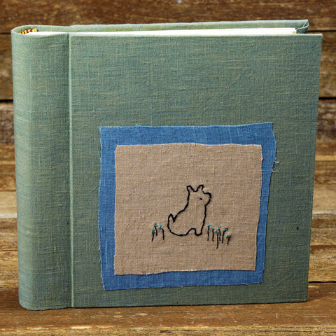 plant dyed linen album with embroidered patch - dog