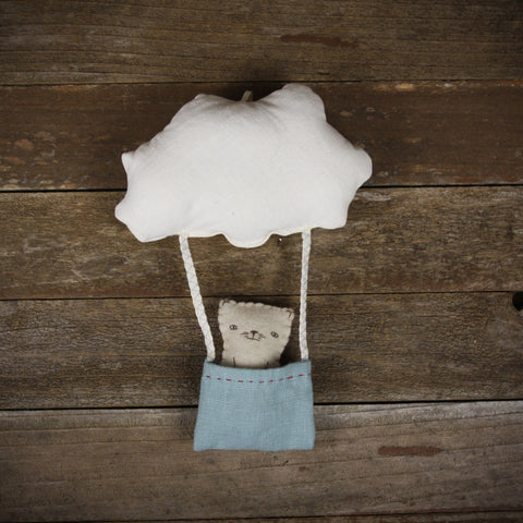 cloud and bucket with finger puppet: cat