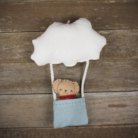 cloud and bucket with finger puppet: dog
