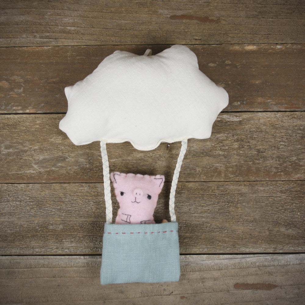 cloud and bucket with finger puppet: pig