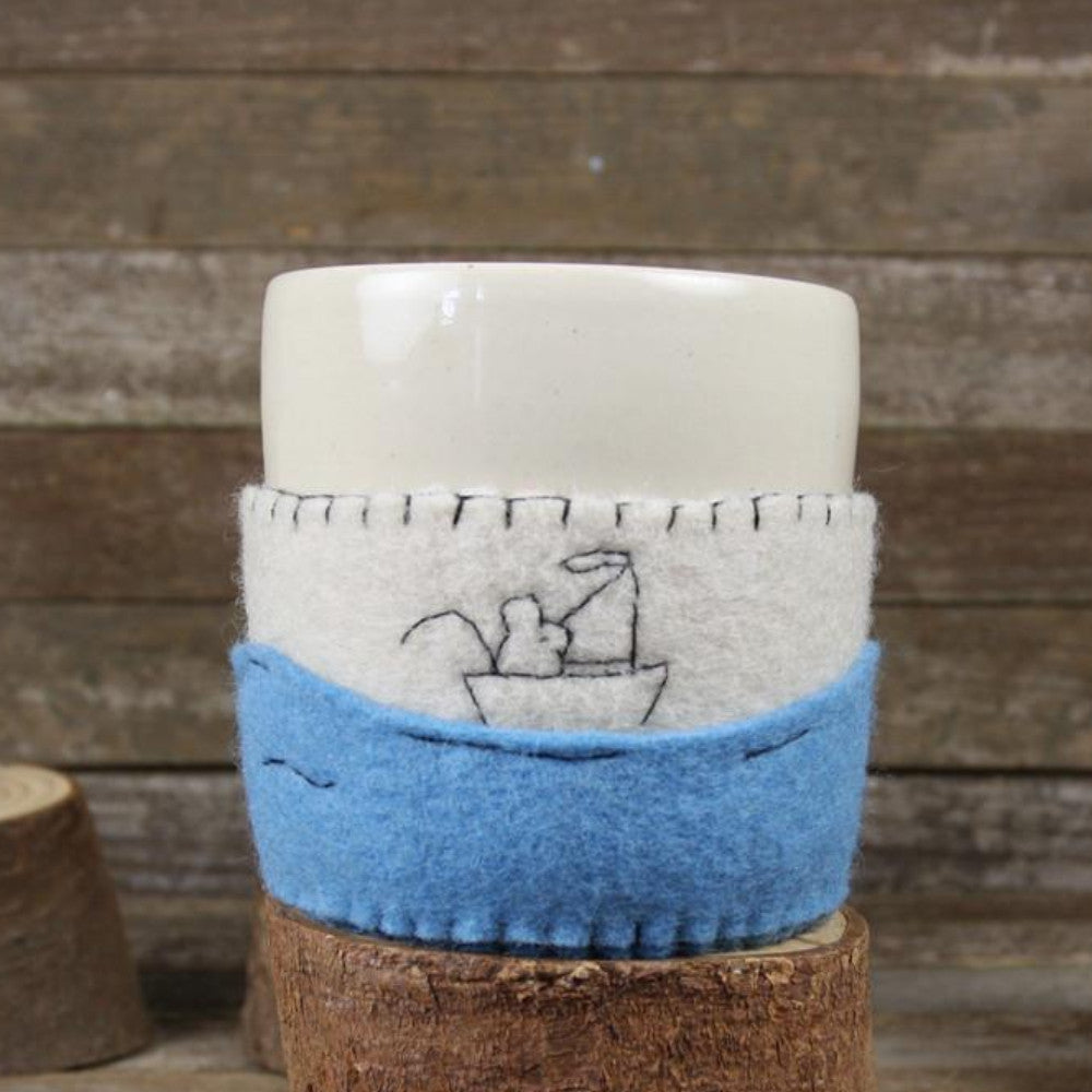 cup in cozy: boat at sea