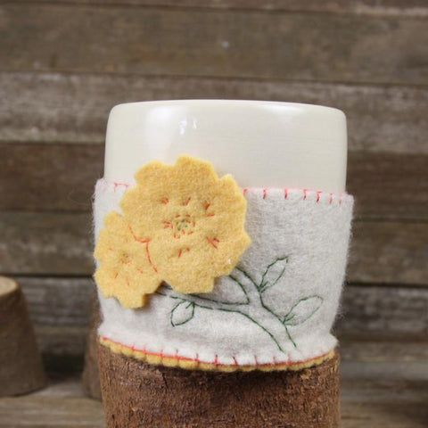cup in cozy: yellow flower