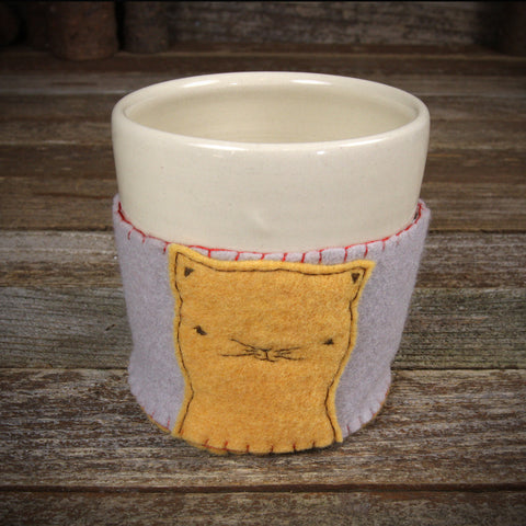 cup in cozy: cat