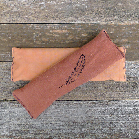 eye pillow: terracotta [stitched feather & plain]