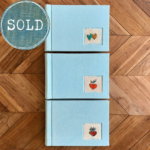 photo albums: hearts on blue