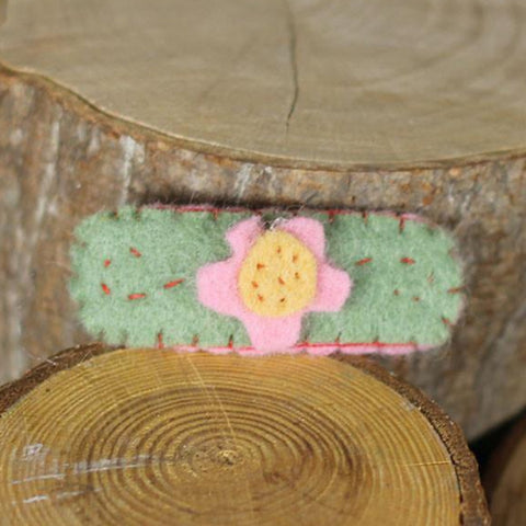 hair clip: pink and yellow flower on moss green