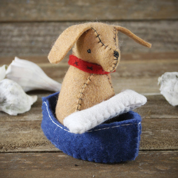 wool felt toy: dog and bone in boat