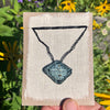 hand-stitched indigo amulet charm with adjustable clasp: diamond