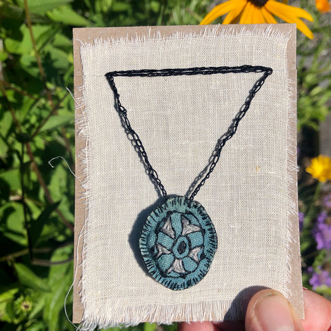 hand-stitched indigo amulet charm with adjustable clasp: pie