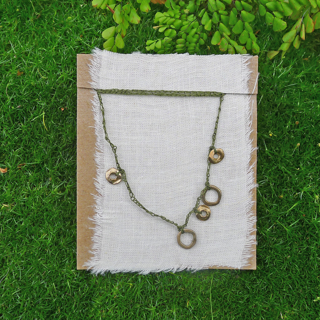 five charm necklace: loop and ring