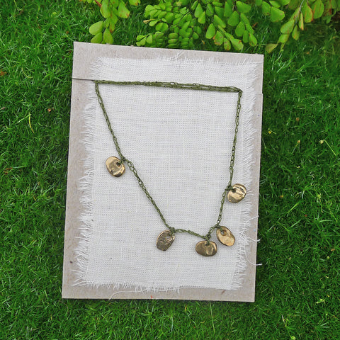 five charm necklace: pebble and pond