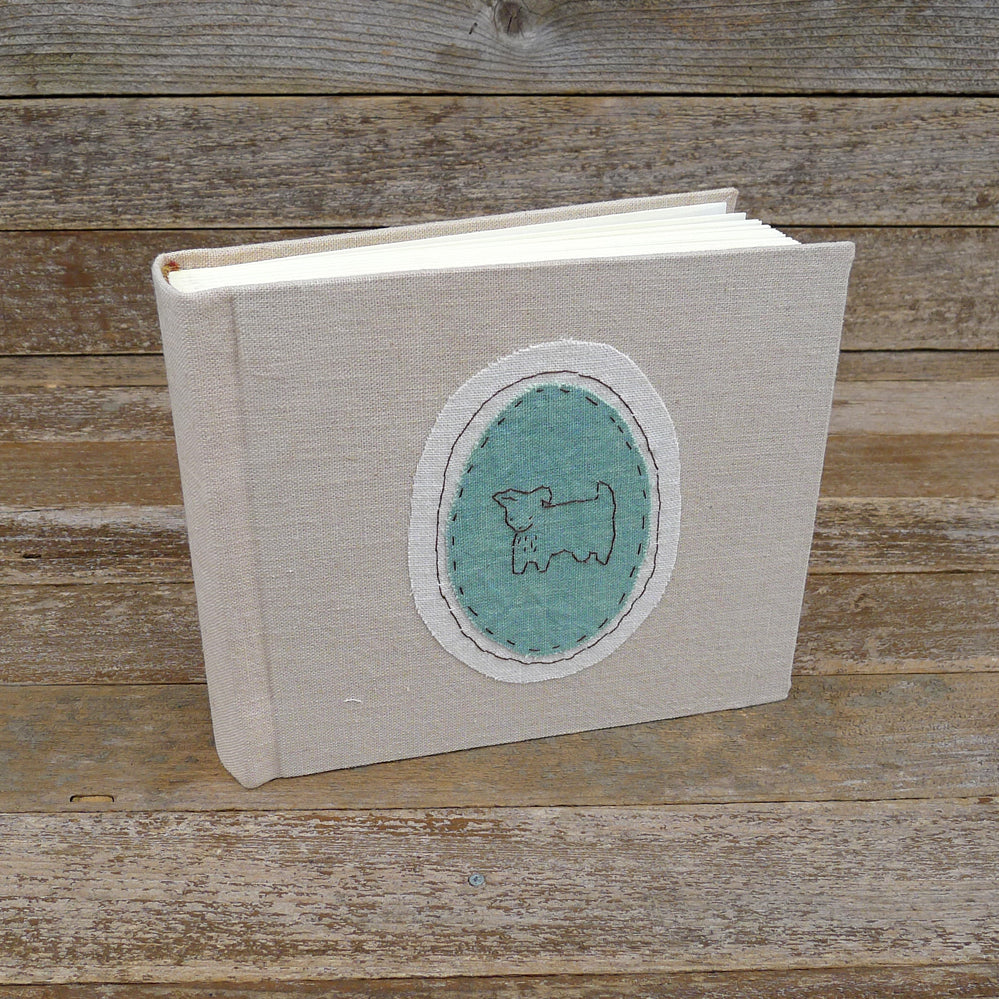 tea-dyed photo album with animal patch: dog/green
