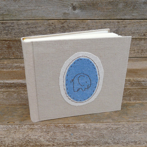 tea-dyed photo album with animal patch: elephant/blue