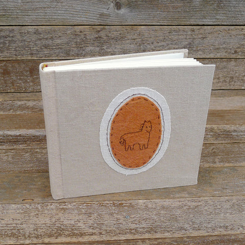 tea-dyed photo album with animal patch: horse/orange