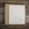 linen album with embroidered felt patch: bear