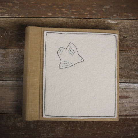 linen album with embroidered felt patch: bird