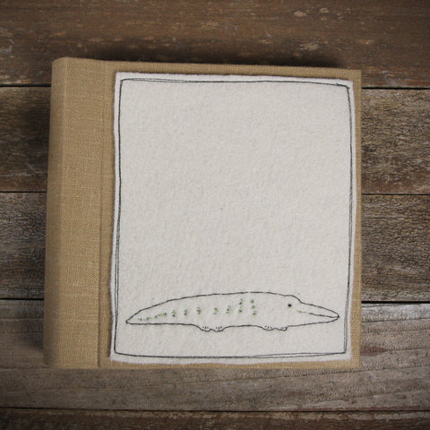 linen album with embroidered felt patch: crocodile