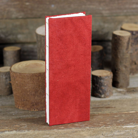 tall and thin hand-bound journal: red