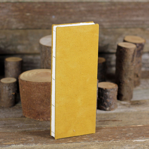 tall and thin hand-bound journal: ochre
