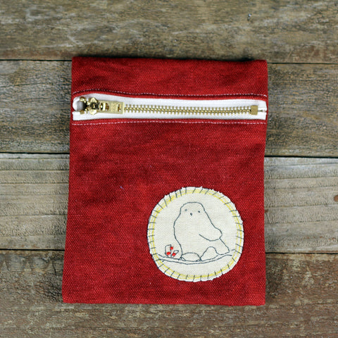 red zipper pouch: bird