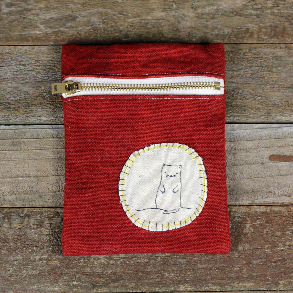 red zipper pouch: cat