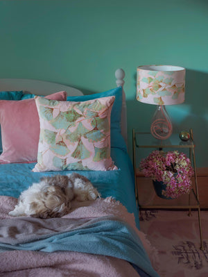Jade and pink velvet cushion - Ginkgo in Jade glass lamp on Rose flex - designed by Anna Jacobs, in a bedroom lifestyle setting