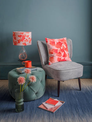 Ginkgo in Coral lamp on Rose flex glass lamp base and Ginkgo in Coral velvet cushion designed by Anna Jacobs
