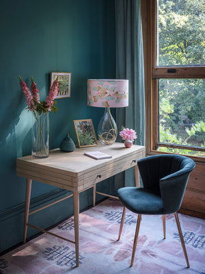 Ginkgo in Jade glass lamp on gold flex, designed by Anna Jacobs, in a home office lifestyle setting