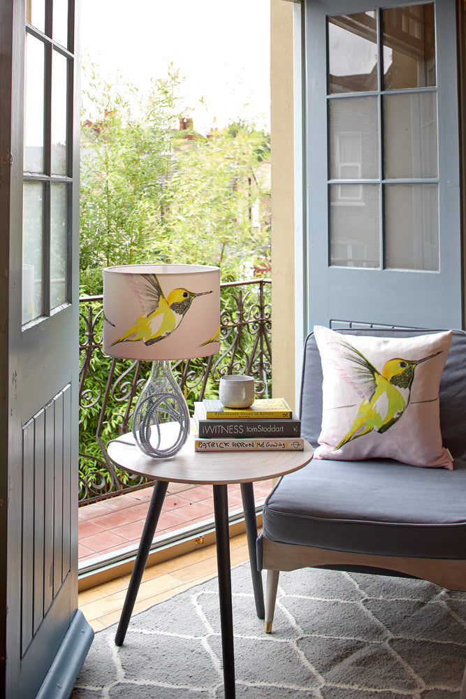 Lemon Hummer medium lamp with grey zig zag flex, in a lifestyle setting with lemon hummer linen cushion