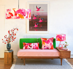 Anna Jacobs Falling leaves in Autumn linen bolster lifestyle image on sofa with lamp and shade