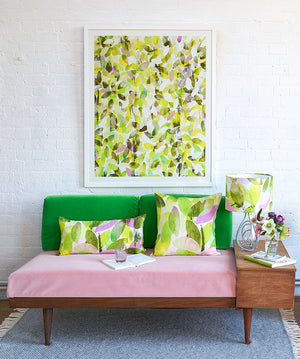 Anna Jacobs Falling leaves in Spring linen bolster lifestyle on sofa with lamp and Falling leaves in Spring print