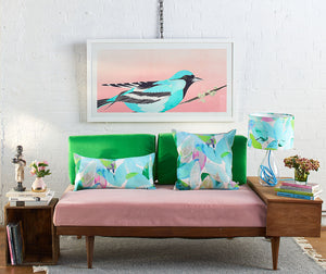 Anna Jacobs Falling leaves in Summer linen bolster lifestyle on sofa with lamp and a Moment to Reflect print