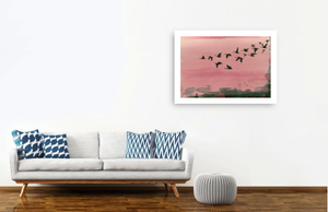 Urban Flight in Rose picture by British artist Anna Jacobs hanging on wall beside sofa