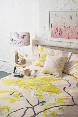 Anna Jacobs Chinese Tree in Blush bed linen in a lifestyle setting with Afternoon Dreaming print on the wall, Beak Street in Rose cushion and Rose Hummer lamp on Rose flex