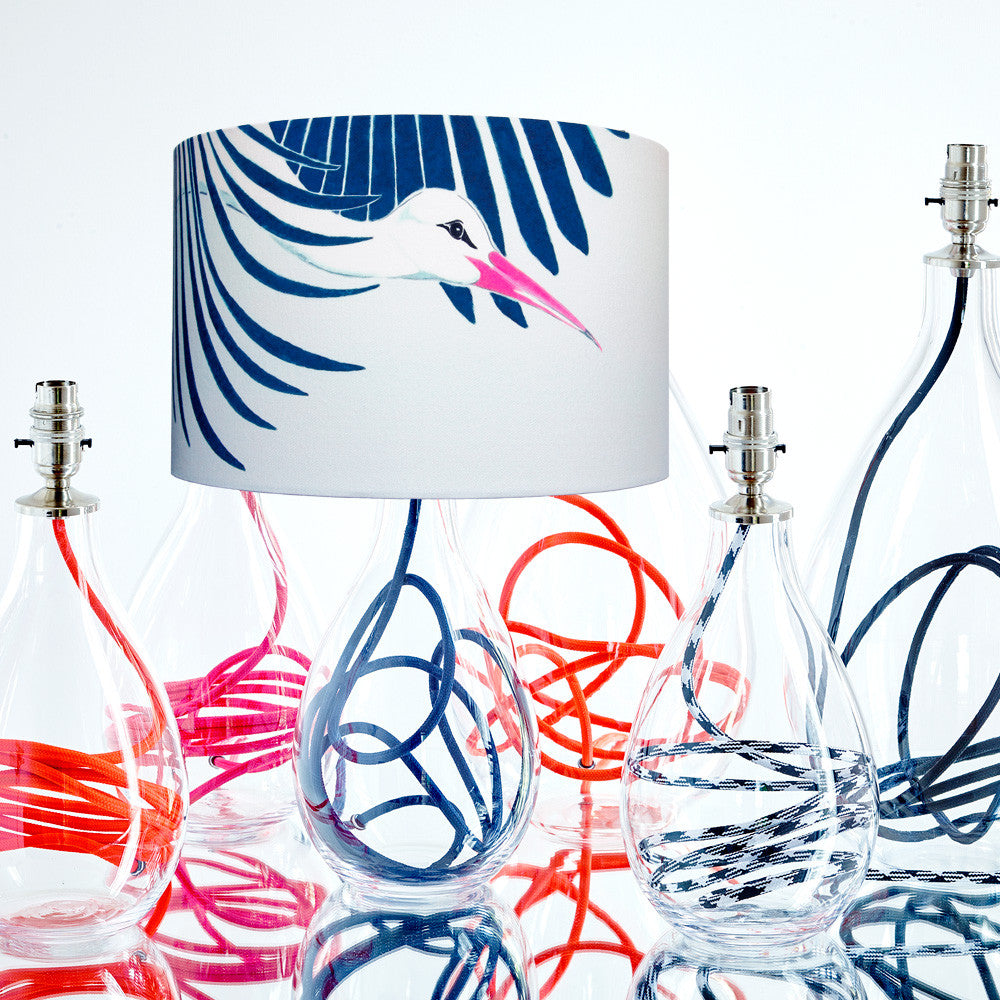 Snow Peak Unbound medium lamp with indigo flex among crystal glass lamp bases with various coloured flexes