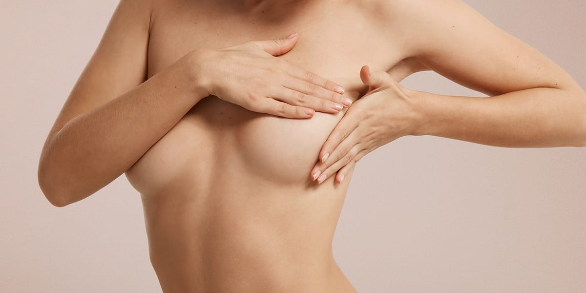 Lady looking for signs and symptoms attributed to breast cancer
