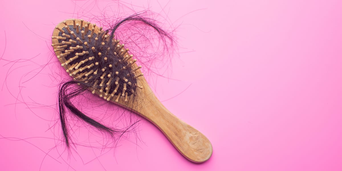 A brush with hair that's fallen out