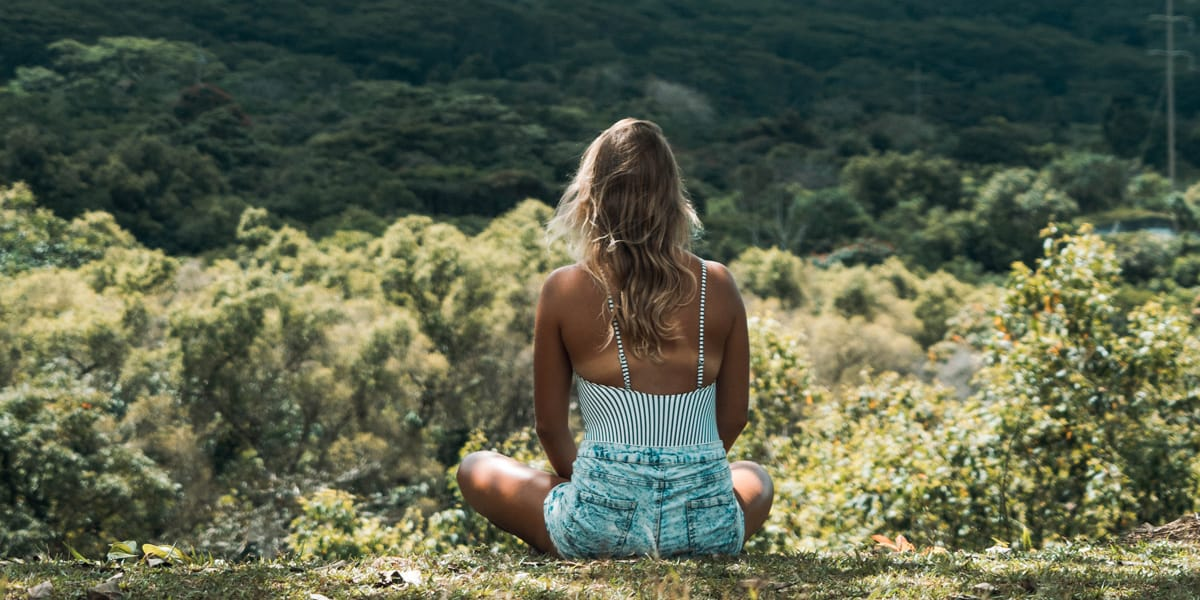 Lady spending time in nature to avoid stress related hair loss