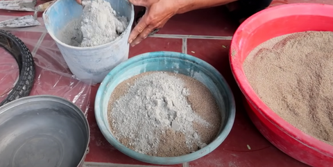 Combine sand, cement, and water