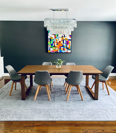 Modern dining table with stylish chairs.