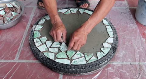 Put ceramic tiles on the surface.