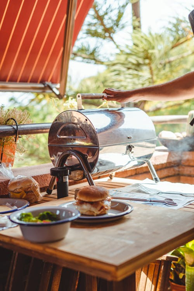 A meat smoker in an outdoor kitchen.