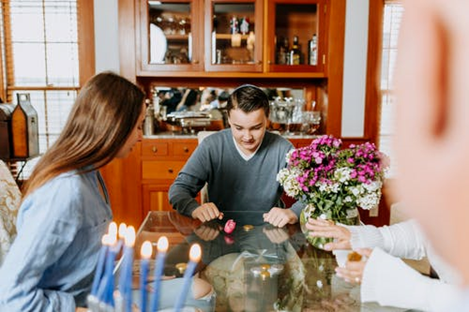 a family playing a game on a glass dining table
