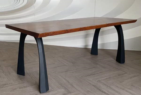 A Wooden Tabletop Supported by Metal Legs