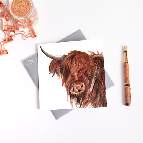 highland cow watercolour by Meg Hawkins