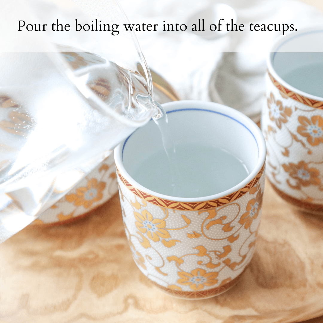 Pour the boiling water into all of the teacups.