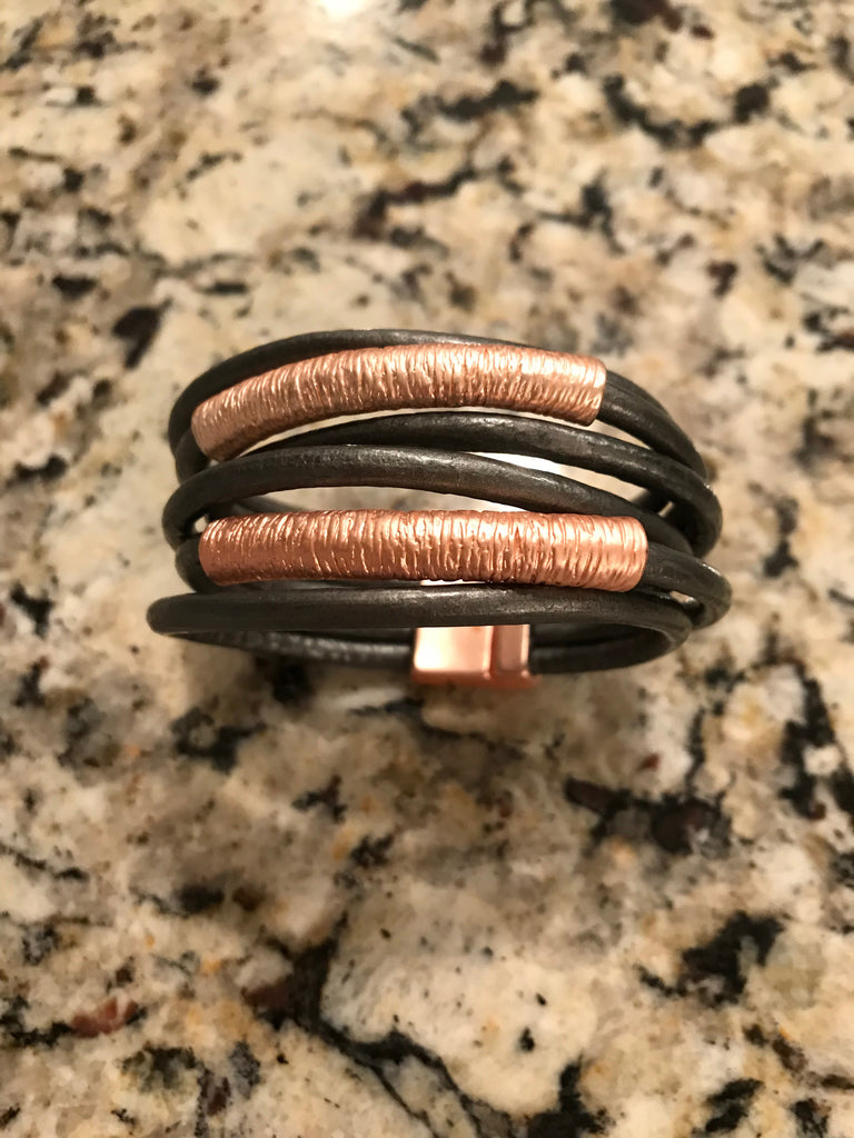 Leather multi-strand bracelet with rose gold accents magnetic closure