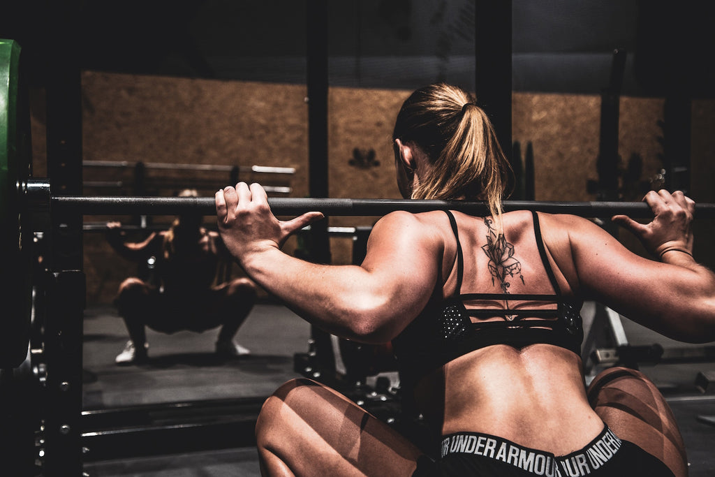 Strong woman lifting weights