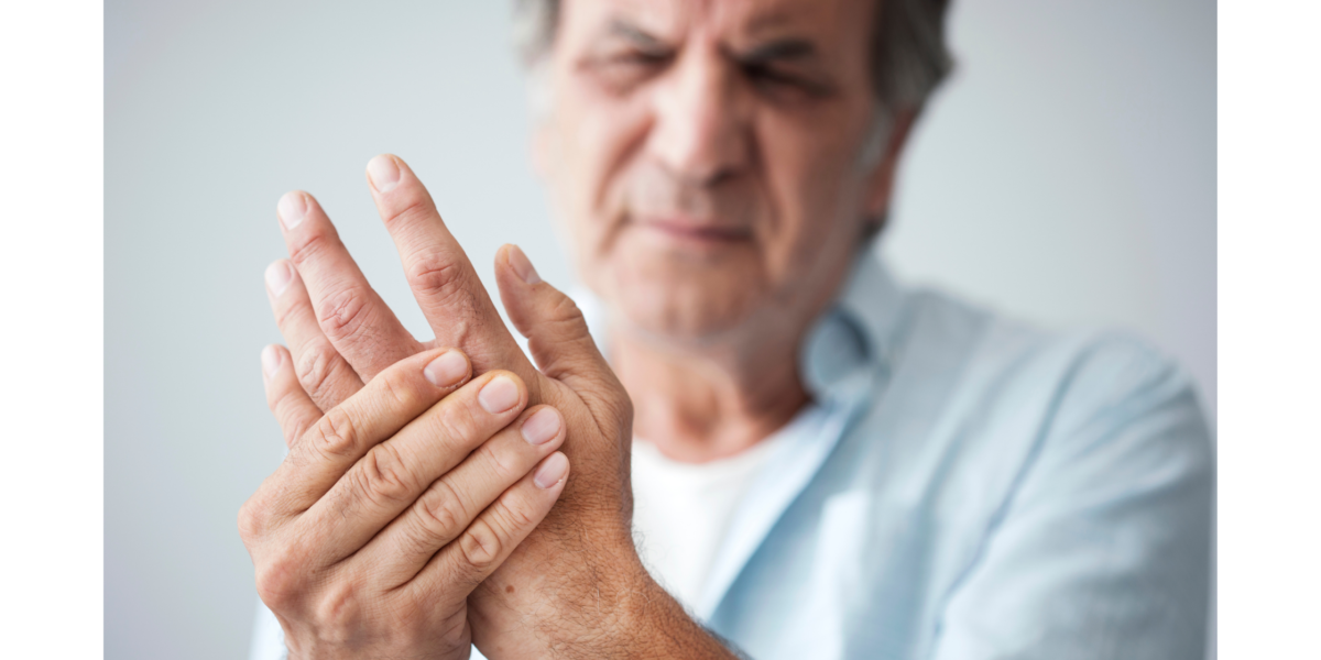 Man suffering with Arthritis in his hand